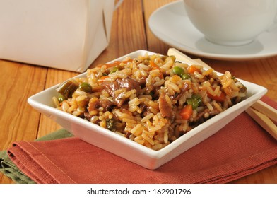 Beef pepper steak and fried rice with vegetables and a cup of tea