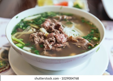 Beef Pho is a Vietnamese soup consisting of broth, rice noodles called banh pho, a few herbs, and meat, primarily made with either beef or chicken.