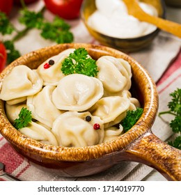 Beef and Pork Pelmeni - Russian Meat Dumplings on White Wooden Background. Selective focus.