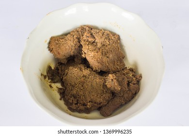 beef rendang is food from Minang, Padang, Sumatra Indonesia, on bowl, isolated white background