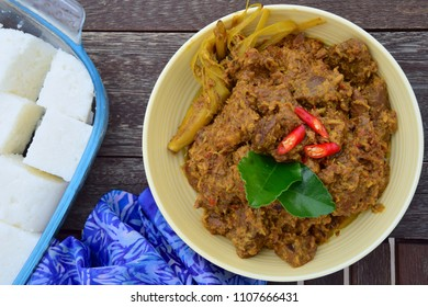 Beef Rendang. Traditional Indonesian dish served during Eid al Fitr or Idul Fitri. Served with compressed rice cake or lontong