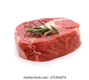 Beef ribeye steak garnished with sprig of rosemary, isolated