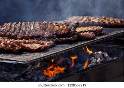 Beef Ribs Cooking on Barbecue Grill at a Local Community Event