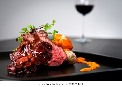 Beef roast with shallot and mushroom wine gravy and side of salt crusted potatoes with red mojo sauce