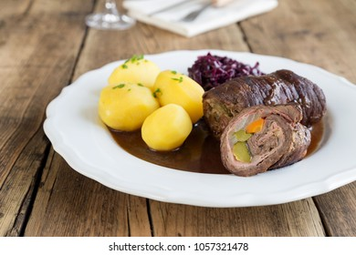 Beef roulade with potatoes and red cabbage