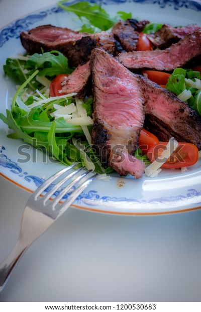 Beef with salad on a plate