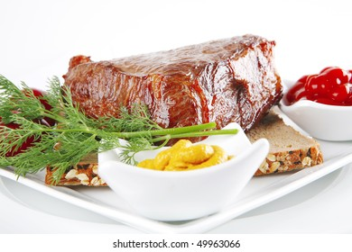 beef and sauces with seasoning on white