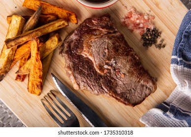 Beef Scotch fillet served with Kumara fries/Sweet potatoes fries and gravy sauce