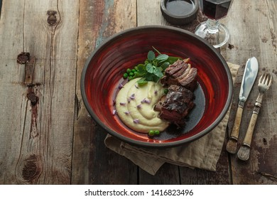 Beef short ribs with parsnip buree, copy space