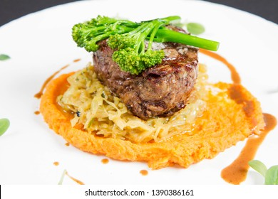 Beef sirloin with sweet potato mousse, curry sauerkraut and fresh thyme sauce