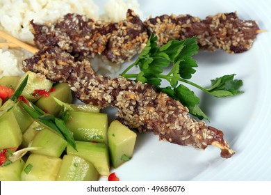 Beef skewers grilled with sesame