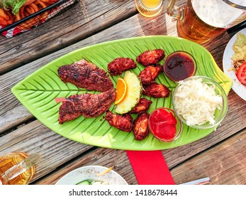 Beef steak with chicken wings and white cabbage salad, top view