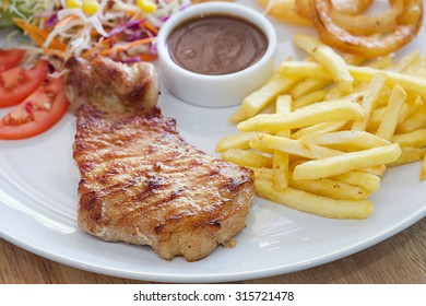 Beef steak and chips with salad,selective focus.