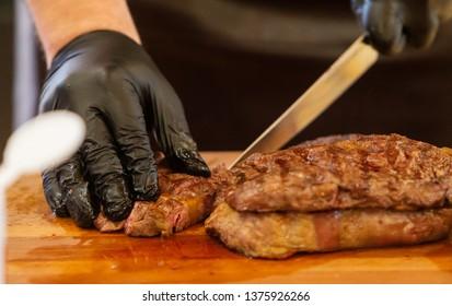 Beef steak cooking. Rib eye steak. Raw meat. Juicy marbled meat on BBQ grill. Medium rare meat roasting