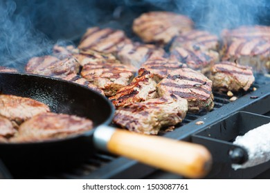 Beef steak cooking. Rib eye steak. Raw meat. Juicy marbled meat on BBQ grill. Medium rare meat roasting