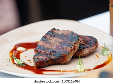 Beef steak cooking. Tasty barbecue. Rib eye steak. Raw meat. Juicy marbled meat on BBQ grill. Medium rare meat roasting