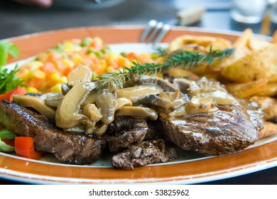 Beef steak dressed with mushroom sauce