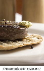 Beef Steak Fillet on Toasted Baguette Bread with Melting Butter and Herbs