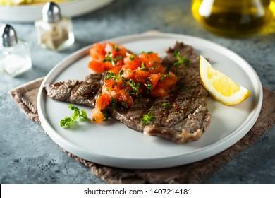 Beef steak with fresh tomato salsa