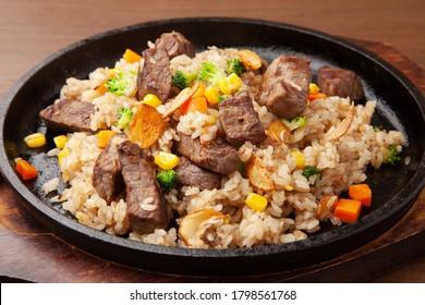 Beef steak and garlic rice