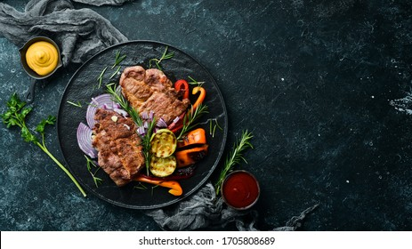 Beef steak. Juicy veal steak with rosemary and spices. Top view. Barbecue.