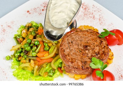 Beef steak meat with vegetables and sauce