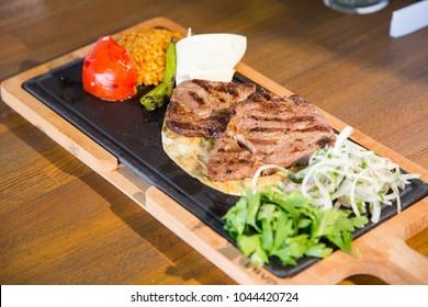 beef steak on iron plate