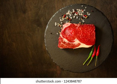 beef steak raw (Grilled meats with spices) - a piece of meat. Top view with copy space