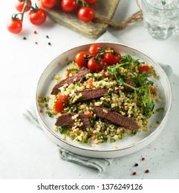 Beef steak salad with bulgur