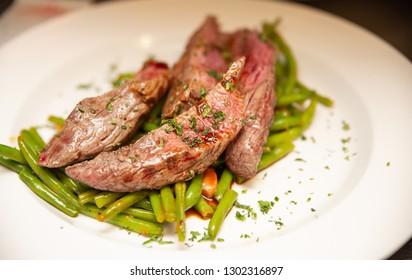 Beef steak tenderloin with grilled beans vegetables