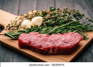 Beef steak with thyme, rosemary and garlic