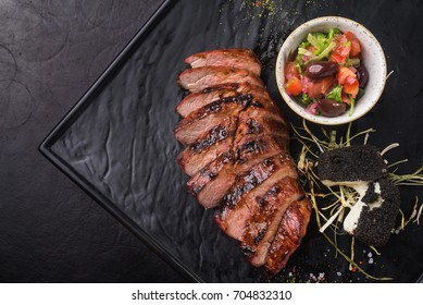 beef steak with tomato salad serving in a restaurant