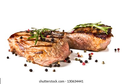 Beef steaks medium grilled, isolated on white background