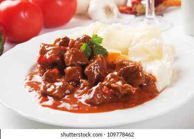 Beef stew or goulash, served with noodles