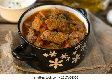 Beef stew goulash style in tomato sauce with carrots and leeks
