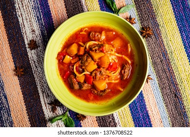 beef stew (or soup) with a rich paprika seasoned broth
