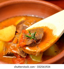beef stew over a wooden board