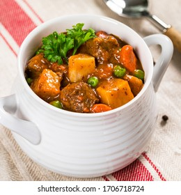 Beef Stew with Potatoes and Carrots made in a Slow Cooker. Selective focus.