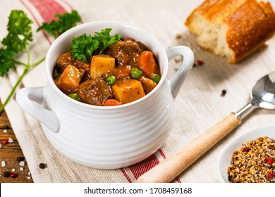 Beef Stew with Potatoes and Carrots on Wooden Background. Selective focus.