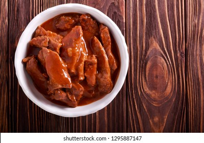 Beef stew - beef strips in gravy in a bowl