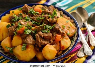 Beef stewed with vegetables, uzbek oriental style cuisine.