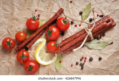Beef sticks, sausages on a paper background. Stylish flat lay.
