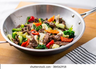 Beef stir-fry with healthy vegetables. Made with flank steak, peppers, onions and bok choy, stir fried in an asian wok.