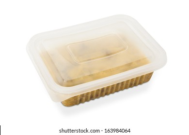 Beef Stroganoff closed package for freezing or to go on brown leather background.