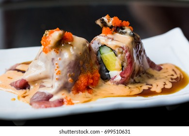 Beef sushi on white plate, Japanese cuisine