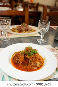 Beef tail stew on arranged restaurant table