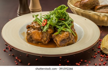 beef tails stew with wine and vegetables