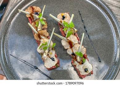 Beef tartar with black truffles and artichoke