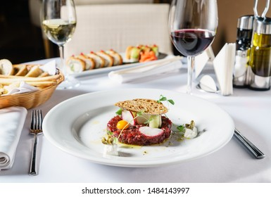 beef tartar with egg and wine