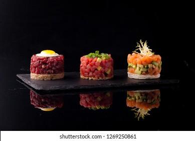 beef tartare, salmon and tuna tartare